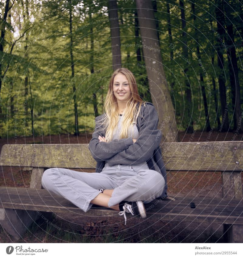 Young woman sitting on a bench in a forest Joy Beautiful Wellness Life Trip Youth (Young adults) 18 - 30 years Adults Environment Nature Spring Summer