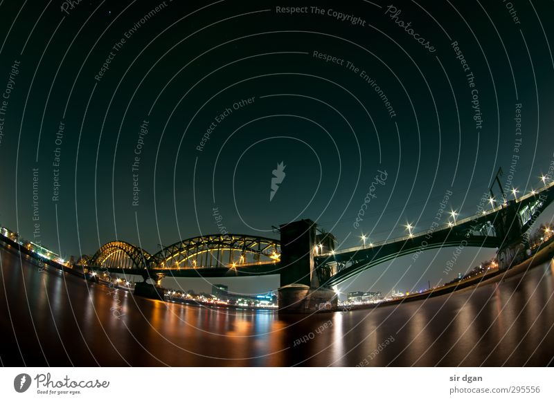 Night lights Leisure and hobbies Trip City trip Winter Industry Water Night sky Beautiful weather River bank Cologne Skyline Bridge Manmade structures Observe