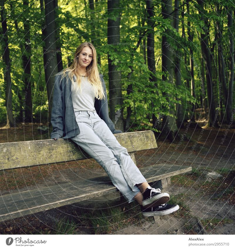 Young woman sitting on a bench in a forest Joy pretty Wellness Life Youth (Young adults) 18 - 30 years Adults Nature Landscape Beautiful weather Forest Jeans