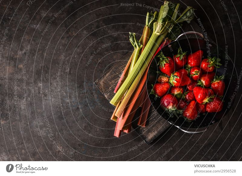 Rhubarb and strawberries on a rustic kitchen table Food Fruit Nutrition Organic produce Vegetarian diet Diet Shopping Style Design Healthy Eating Summer Table