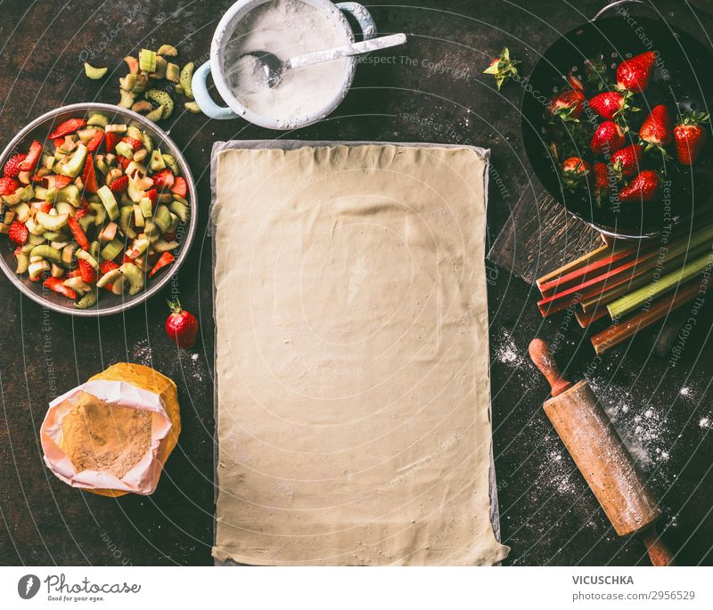 Leaf of dough with rhubarb and strawberries Food Fruit Dough Baked goods Cake Nutrition Crockery Style Design Healthy Eating Summer Living or residing Table