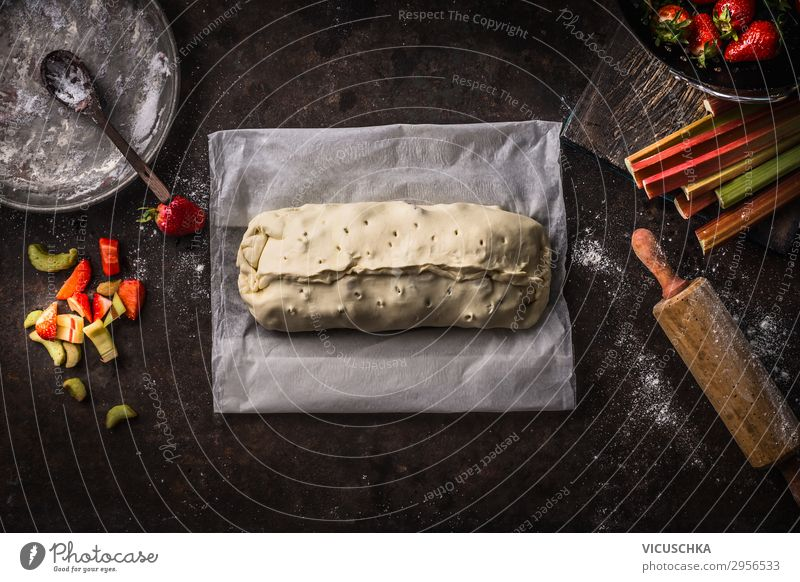 Preparation of rhubarb and strawberry strudel cake Food Fruit Dough Baked goods Cake Nutrition Organic produce Crockery Summer Design Style Background picture