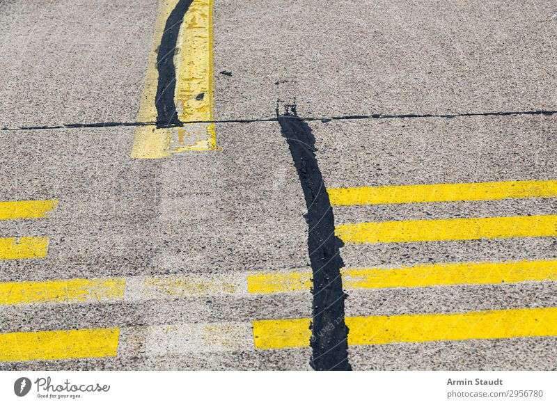 streetart airstrip runway asphalt sign road road marking old used abstract background outdoor closeup symbol urban transport transportation shape traffic