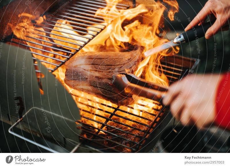 steak surrounded by high flames on a grill Working barbecue bbq beef beefsteak chef cut delicates entrecote expensive fat filet fillet fire flame kissed flavour