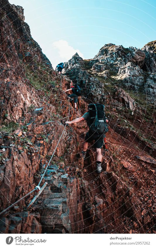 Dolomites with hikers on the via ferrata Adventure Hiking Beautiful weather Bad weather Fog Peak Summer Landscape Nature Environment Far-off places Freedom