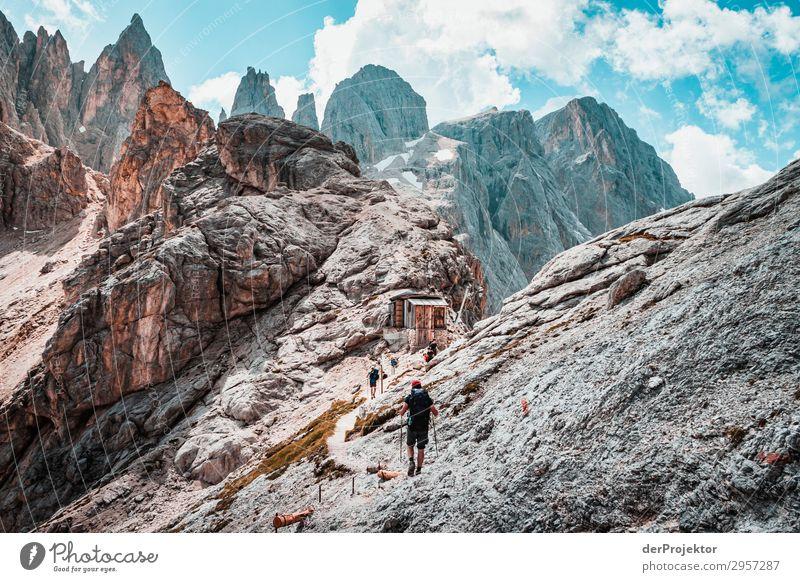 Dolomites with hiker in foreground II Adventure Hiking Beautiful weather Bad weather Fog Peak Summer Landscape Nature Environment Far-off places Freedom