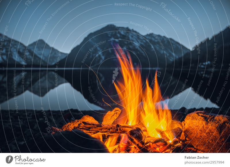 Fire at Plansee Trip Adventure Camping Mountain Nature Landscape Water Cloudless sky Sunrise Sunset Alps Snowcapped peak Lakeside Illuminate Fantastic Natural
