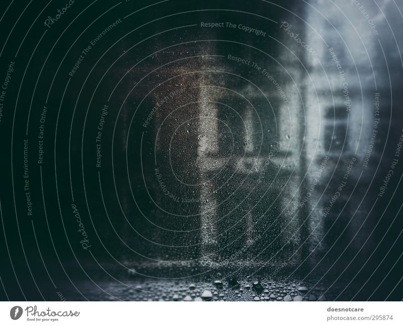 Fogged window with view of the facade of an old building Bad weather Rain Wet Misted up Damp gay Drop Drops of water Window Window pane Glass Pane conceit