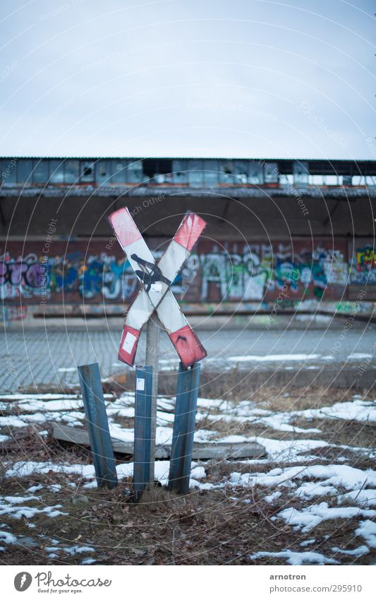 railroad crossing Winter Ice Frost Snow Grass Berlin Germany Town Deserted Industrial plant Transport Logistics Road sign Rail transport St. Andrew's Cross