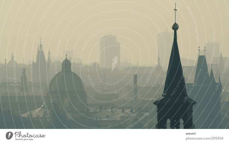 The towers of Prague Fog Town Skyline High-rise Church Dome Tower Architecture Roof Tourist Attraction Crucifix Dirty Sharp-edged Far-off places Large Historic