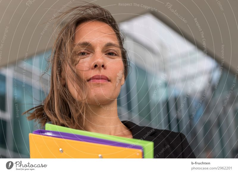 Woman with colourful folders in front of office building Education Science & Research Study Professor Office work Economy Services Business Career Adults