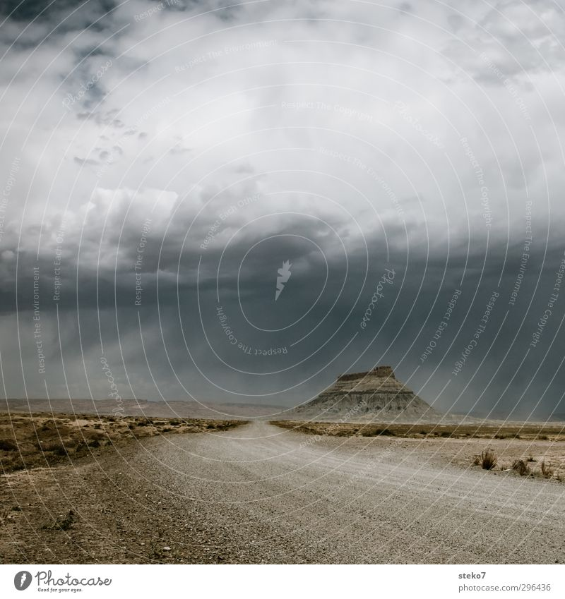 Loneliness Far-off places Mountain Gray Travel photography Brown Rock Rain Desert Thunder and lightning Bad weather Storm clouds Apocalyptic sentiment Utah