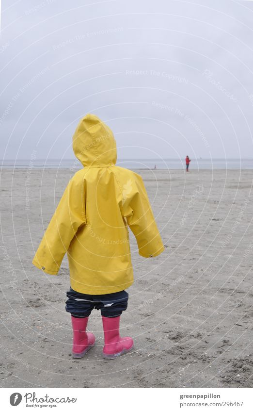 Schietwetter - Girl in the Friesennerz has wanderlust Feminine Child Toddler 1 Human being 2 Relaxation Experience Healthy Infancy Tourism Dream Environment