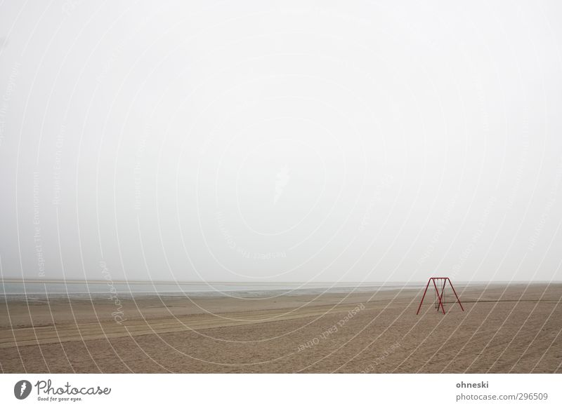lost Bad weather Coast Beach North Sea Langeoog Swing Sand Reluctance Fear Loneliness Far-off places Colour photo Subdued colour Exterior shot Deserted