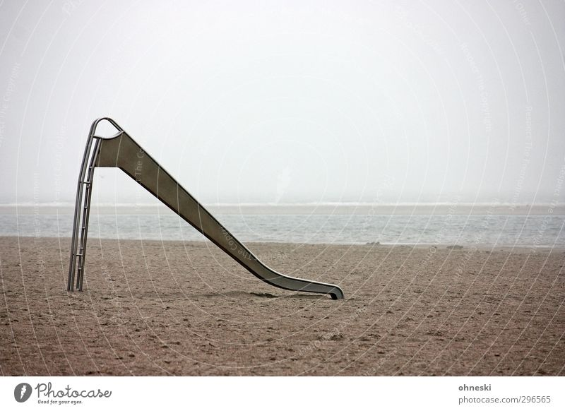 sand slide Playing Beach Ocean Coast North Sea Langeoog Slide Sand Reluctance Loneliness Stagnating Far-off places Colour photo Subdued colour Exterior shot