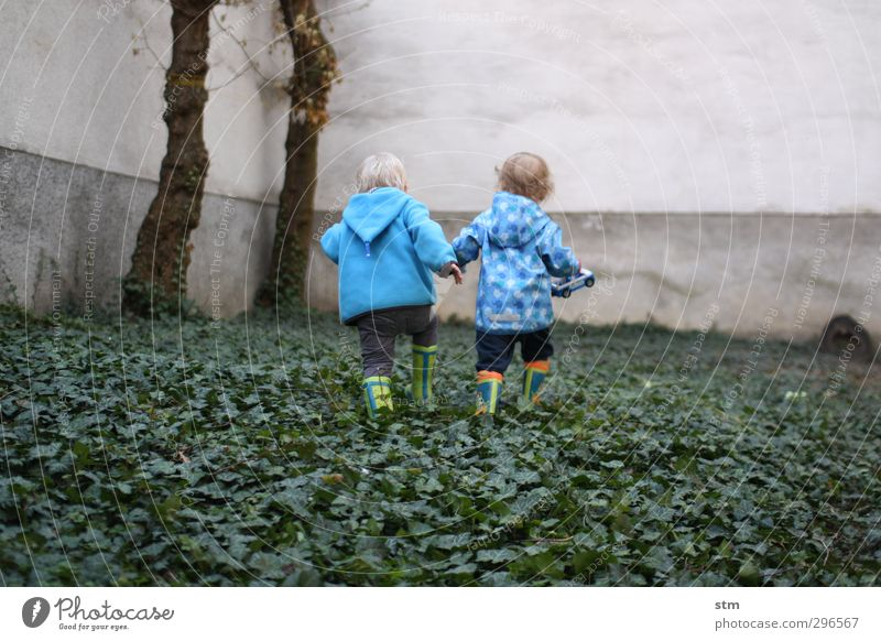 Human being Child Blue City Wall (building) Life Playing Movement Boy (child) Wall (barrier) Happy Garden Friendship Infancy Leisure and hobbies Walking