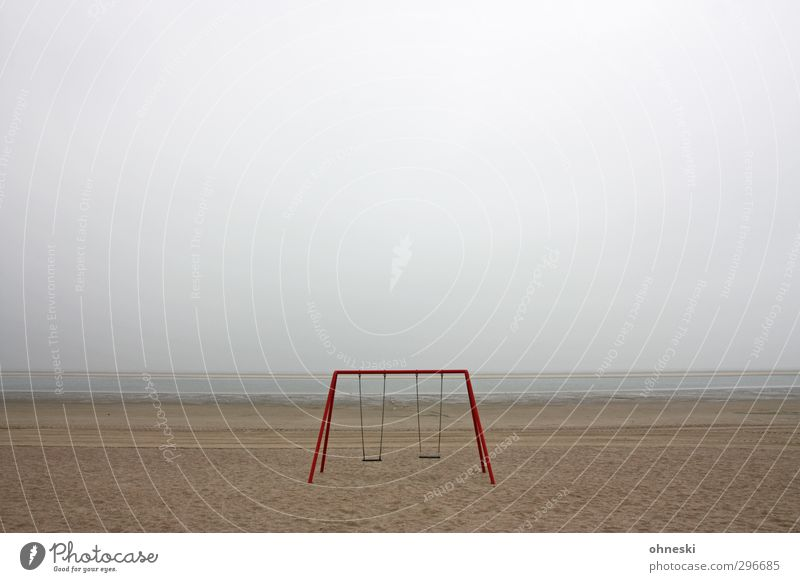 playground Playground Swing Sand Bad weather Coast Beach North Sea Langeoog Deserted Loneliness Fear Apocalyptic sentiment Far-off places Colour photo