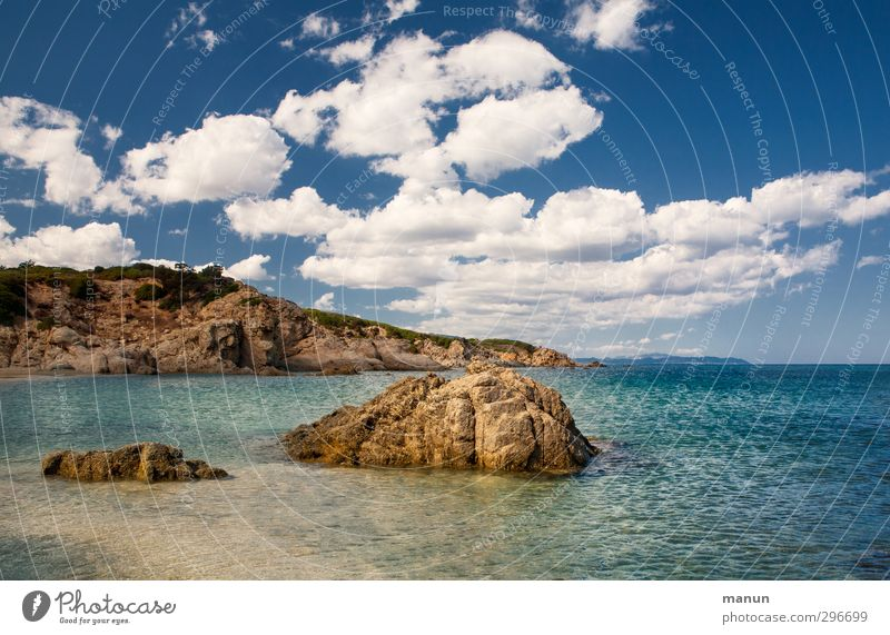 Sky Nature Vacation & Travel Water Summer Ocean Landscape Beach Far-off places Warmth Coast Sand Horizon Rock Island Beautiful weather