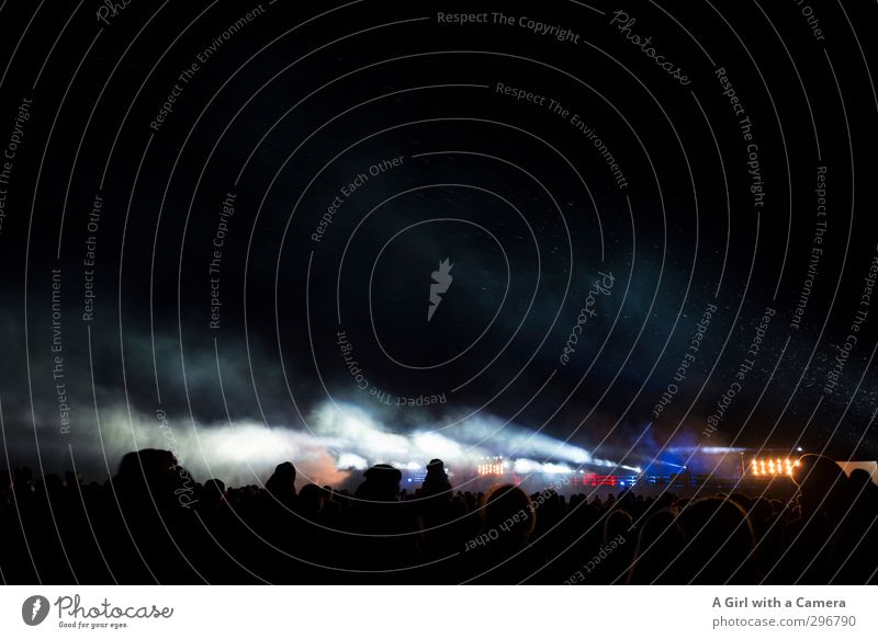 that's what's going on Concert Outdoor festival Stage Illuminate Placed Light show Laser show Dark Crowd of people Enthusiasm Smoke cloud Subdued colour