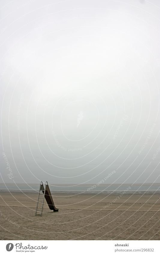 slide tour Sand Clouds Bad weather Coast Beach North Sea Island Langeoog Toys Slide Loneliness Infancy Colour photo Subdued colour Exterior shot Copy Space top