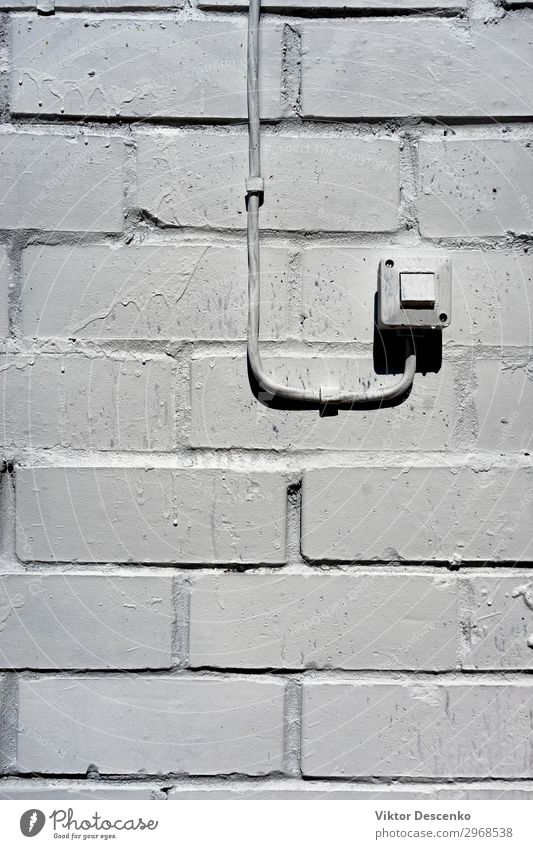 Electrical switch on the white wall House (Residential Structure) Technology Human being Hand Concrete Plastic Old Gray Black White Energy background vintage