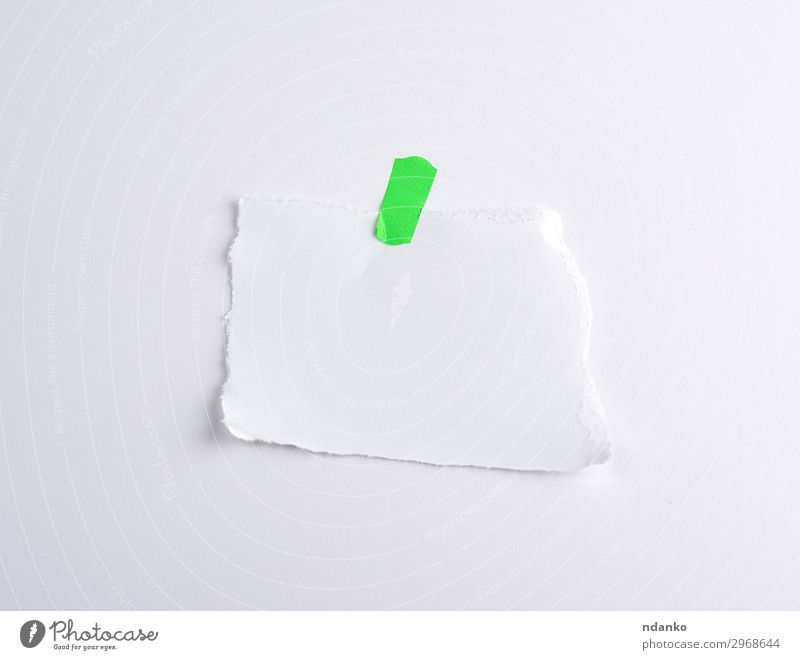 torn off white piece of paper glued to green velcro Office Paper Collection Above Green White Information part element background Banner Blank communication