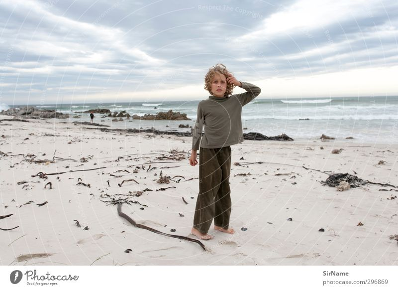 Human being Child Sky Nature Vacation & Travel Ocean Landscape Clouds Beach Environment Far-off places Life Playing Boy (child) Freedom Sand