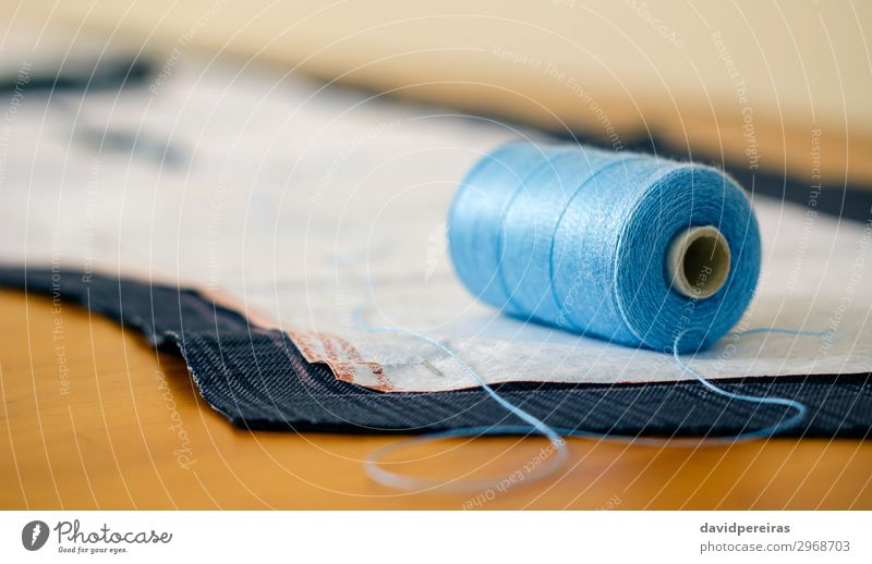 Spool of thread in a sewing workshop Design Leisure and hobbies Table Craft (trade) Business Fashion Clothing Blue dressmaker Atelier Tailor bespoke needlewoman
