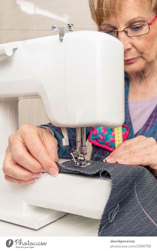 Senior seamstress woman working on sewing machine Design Handcrafts Work and employment Profession Industry Craft (trade) Sewing machine Woman Adults Fashion