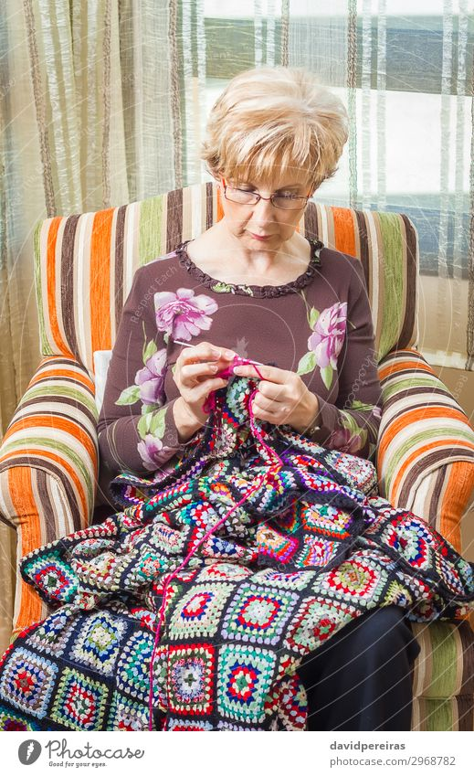 Portrait of woman knitting a vintage wool quilt Relaxation Leisure and hobbies Knit Work and employment Craft (trade) Human being Woman Adults Mother