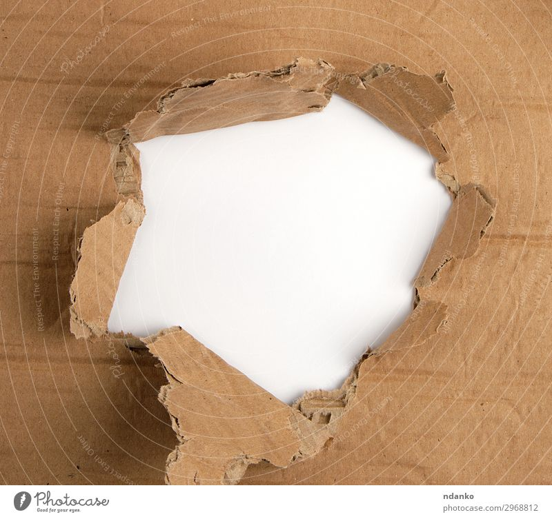 brown sheet of paper with a hole, full frame Design Paper Old Under Brown White Idea background Blank border break Bullet Cardboard circle Conceptual design