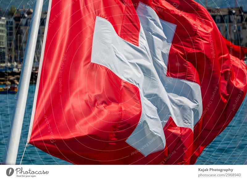 Swiss flag on Lake Geneva Sign Signs and labeling Large Red White Politics and state Switzerland Flag Exterior shot Deserted Day Long shot