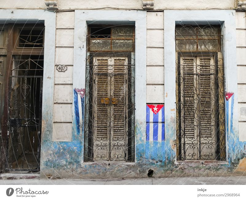 Cuban flags Deserted House (Residential Structure) Facade Window Door Grating Flag Old Authentic Dirty Closed Wooden door Wooden window Painted Weathered