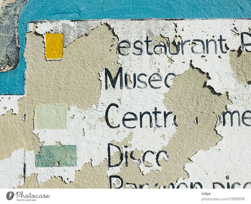 Cuban information sign Deserted Facade Stone Concrete Characters Signs and labeling Old Broken Tourism Decline Transience Weathered Flaked off Colour photo