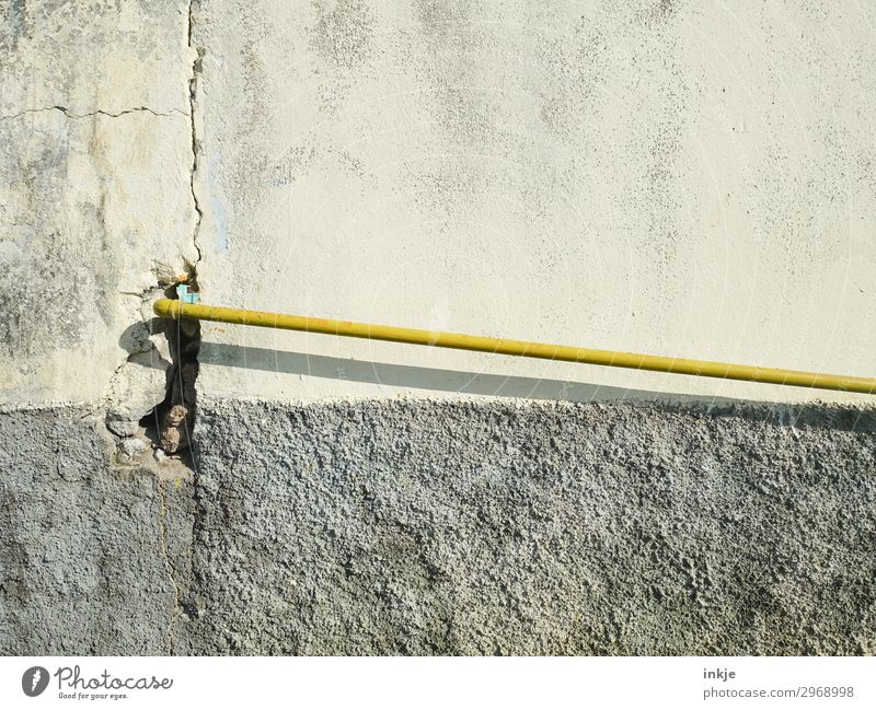 aquatic Cable Technology Deserted Wall (barrier) Wall (building) Facade Pipe Water pipe Conduit Thin Long Yellow Gray Colour photo Exterior shot Close-up Detail