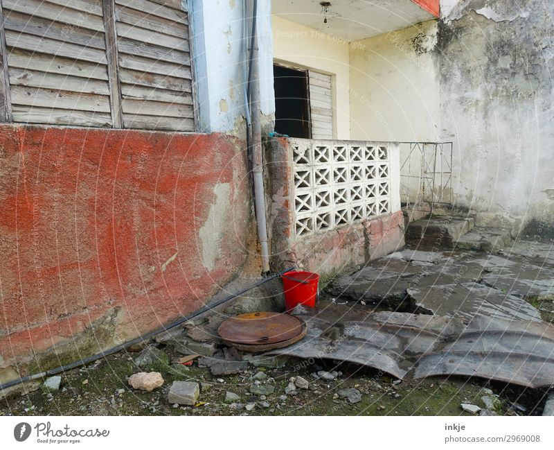 Cuban entrance Deserted Wall (barrier) Wall (building) Facade Terrace Window Door Bucket Old Poverty Authentic Dirty Simple Broken Derelict Colour photo