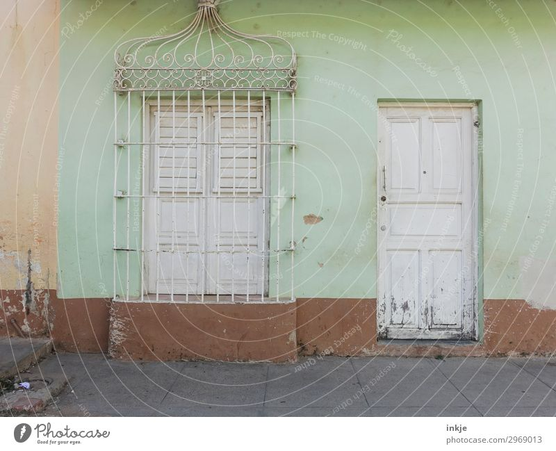 Cuban shop closing time Village Small Town Deserted House (Residential Structure) Facade Window Door Grating Ornament Old Authentic Simple Brown White