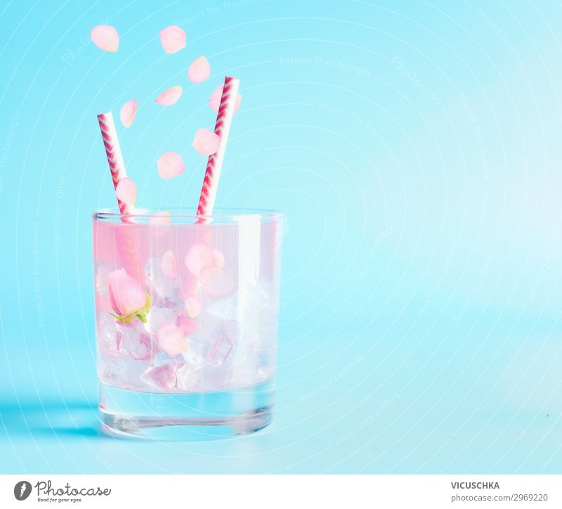 Summer drink with rose petals and flowers. Beverage Cold drink Lemonade Longdrink Cocktail Glass Style Design Table Party Restaurant Bar Cocktail bar Rose Pink