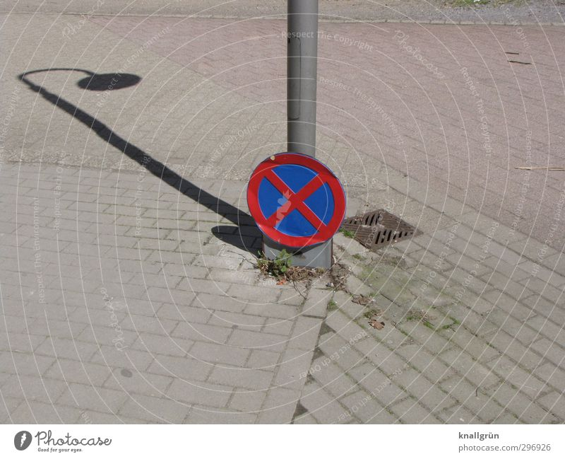 No shadow parkers! Places Transport Motoring Road sign Sign Signs and labeling Signage Warning sign Hang Communicate Dirty Uniqueness Long Round Town Blue Gray