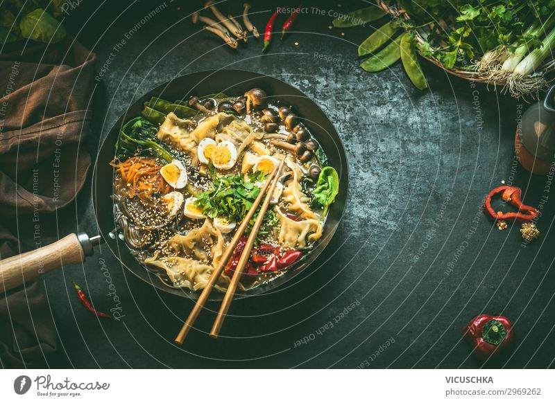Wok pan with korean stew and chopsticks Food Vegetable Nutrition Lunch Organic produce Vegetarian diet Diet Asian Food Style Healthy Eating Table Restaurant