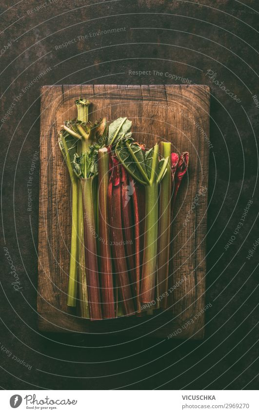 Rhubarb bundles on cutting board Food Vegetable Fruit Nutrition Organic produce Vegetarian diet Style Design Healthy Healthy Eating Table Nature