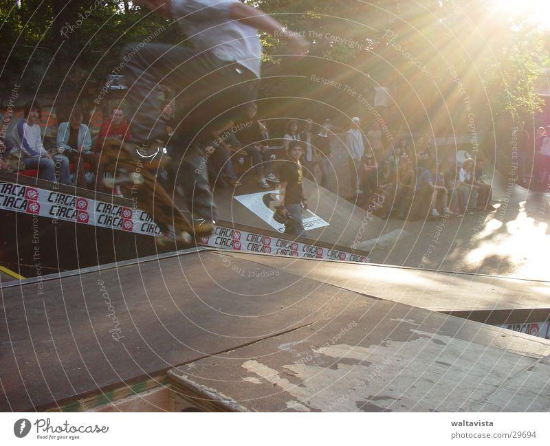 Human being Man Sun Sports Flying Skateboarding Parking level Extreme sports