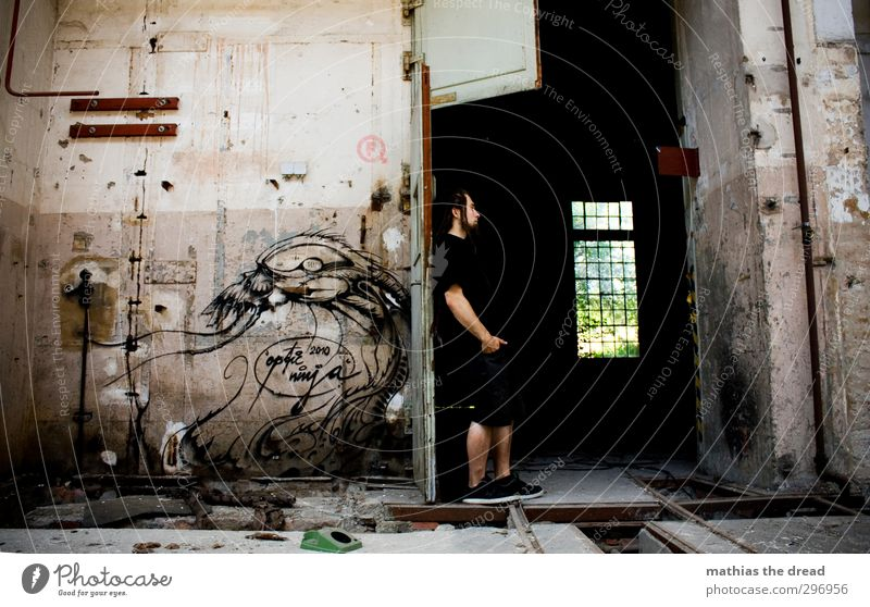 Human being Man Youth (Young adults) Adults Window Graffiti Wall (building) 18 - 30 years Architecture Wall (barrier) Building Exceptional Masculine Door Stand
