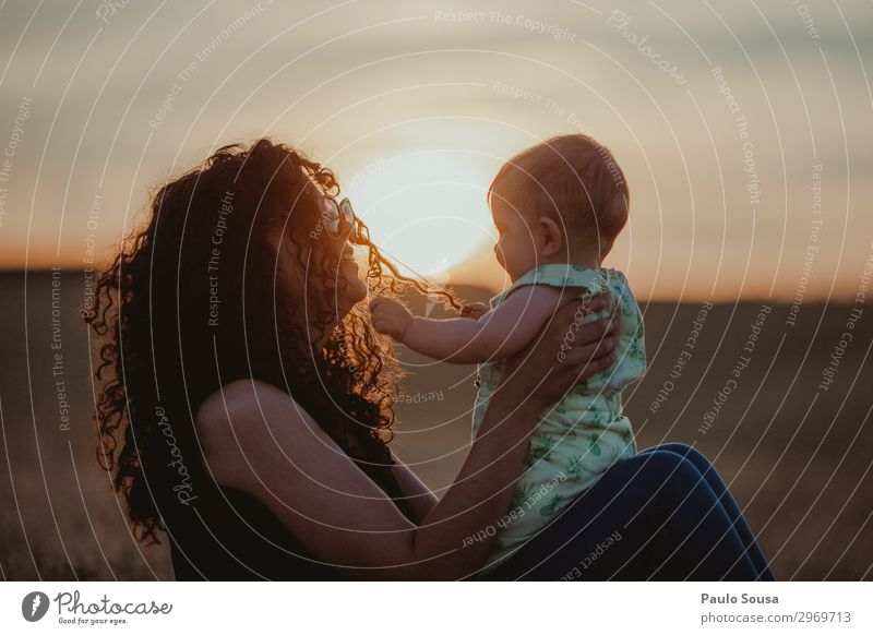 Mother and Daughter at sunset Lifestyle Human being Feminine Child Baby Toddler Girl Adults 2 0 - 12 months 18 - 30 years Youth (Young adults) Curl Touch Love