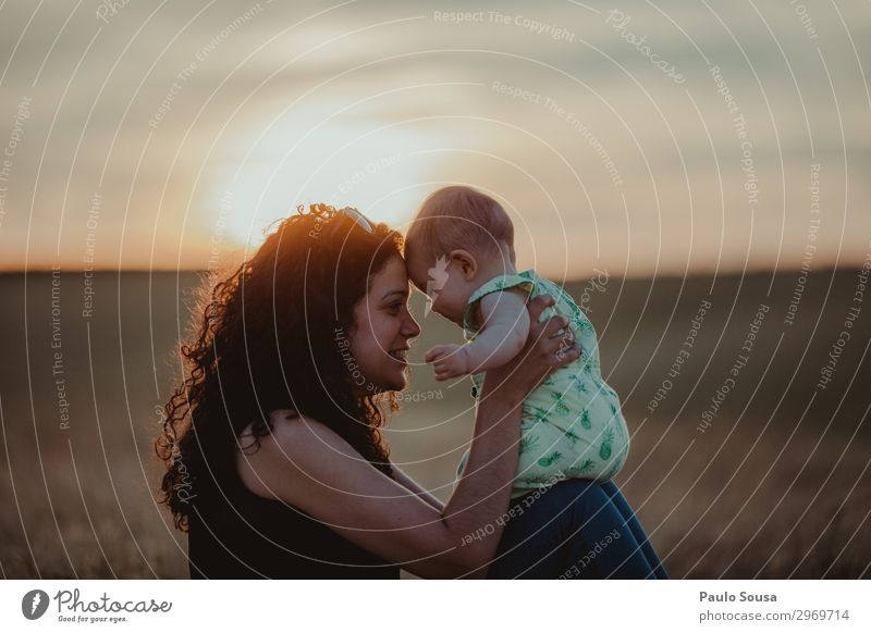 Mother and Daughter at sunset motherhood Family & Relations Together togetherness Sunset Child Happy Lifestyle Happiness Love people Parents Joy Adults Smiling