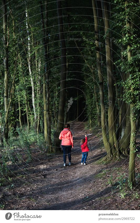 Mother with her little daughter walking through the forest Lifestyle Joy Beautiful Relaxation Leisure and hobbies Vacation & Travel Summer Hiking Child Woman