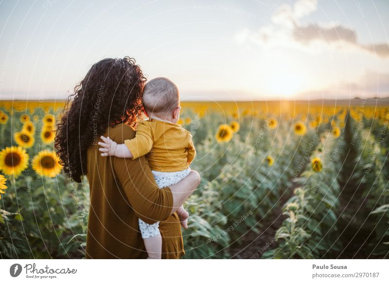 Mother and Daughter in sunflower field Lifestyle Human being Feminine Child Baby Toddler Girl Adults 3 0 - 12 months 18 - 30 years Youth (Young adults)