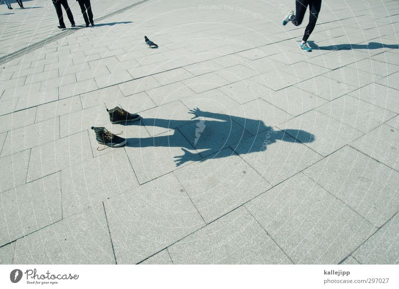a shadow of itself Human being Masculine Body 1 Stand Places Jogger Pedestrian Anonymous Sidewalk Footwear Expressionless Colour photo Exterior shot Light