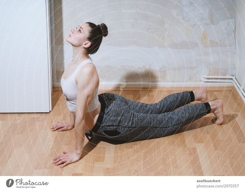 Yoga Pose Cobra Lifestyle Healthy Athletic Fitness Relaxation Leisure and hobbies Living or residing Flat (apartment) Room Sports Sports Training Sportsperson