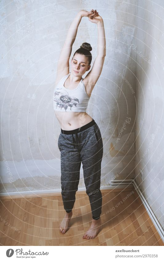 stretching Lifestyle Healthy Athletic Fitness Leisure and hobbies Flat (apartment) Room Sports Sports Training Sportsperson Human being Feminine Young woman